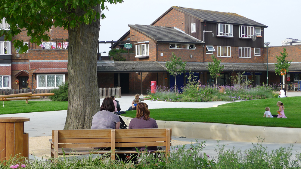Reasons to step outside: this community space was created in place of a derelict building in a tangle of roads, in a previously run-down London suburb. The traffic-free square is surrounded by social housing, local shops, childcare, health and youth facilities and a nursing home and provides a central, connecting, safe, gathering space with trees and grass, seating, planting, play and lighting. Hampton Square, LUC.